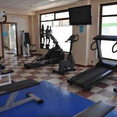 Отель Astuy Apartamentos Арнуэро фитнесс-зал фото 2