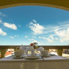 Отель Kanhai's Center of Excellence Гайана, Джорджтаун - отзывы, цены и фото номеров - забронировать отель Kanhai's Center of Excellence онлайн балкон