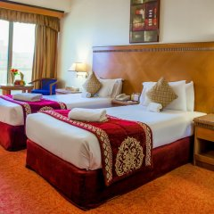 Ramee Guestline Hotel комната для гостей фото 5