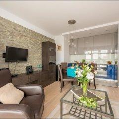 Апартаменты P&O Apartments Okecie 2 комната для гостей
