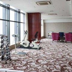 Отель Huaqiang Plaza Hotel Shenzhen Китай, Шэньчжэнь - 1 отзыв об отеле, цены и фото номеров - забронировать отель Huaqiang Plaza Hotel Shenzhen онлайн фитнесс-зал фото 3