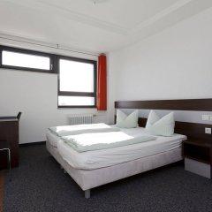 Отель DJH City-Hostel Köln-Riehl Германия, Кёльн - отзывы, цены и фото номеров - забронировать отель DJH City-Hostel Köln-Riehl онлайн комната для гостей фото 5