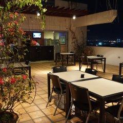 Отель Nichols Airport Hotel Филиппины, Паранак - отзывы, цены и фото номеров - забронировать отель Nichols Airport Hotel онлайн питание фото 2