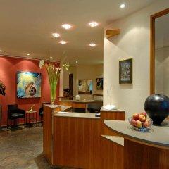 Отель Astor & Aparthotel Германия, Кёльн - отзывы, цены и фото номеров - забронировать отель Astor & Aparthotel онлайн интерьер отеля