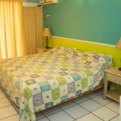 Отель Chrisanns Beach Resort Ямайка, Очо-Риос - отзывы, цены и фото номеров - забронировать отель Chrisanns Beach Resort онлайн комната для гостей фото 2