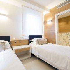 Отель Metropol Ceccarini Suite Риччоне комната для гостей фото 3