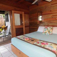 Отель Coconut Grove Beachfront Cottages комната для гостей фото 2