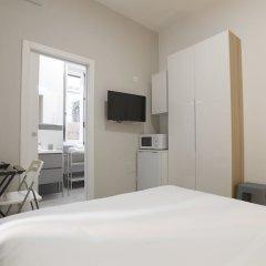 Апартаменты Santi Quattro Apartment & Rooms - Colosseo комната для гостей фото 3