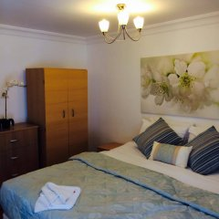 Апартаменты Wellington Road Apartments комната для гостей фото 3