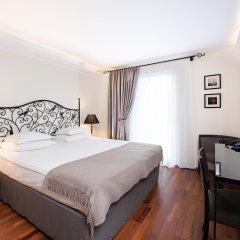 Отель L Ermitage комната для гостей