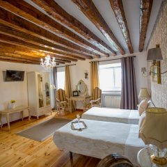 Апартаменты Oriente Palace Apartments комната для гостей фото 2