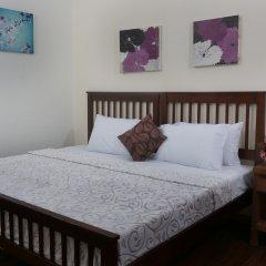 Отель 1775 Adriatico Suites Филиппины, Манила - отзывы, цены и фото номеров - забронировать отель 1775 Adriatico Suites онлайн комната для гостей