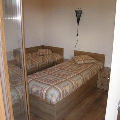 Отель Rodopi Houses Болгария, Чепеларе - отзывы, цены и фото номеров - забронировать отель Rodopi Houses онлайн комната для гостей