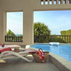 Отель The Cove Rotana Resort бассейн фото 2