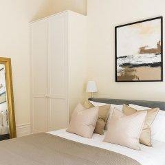 Апартаменты Huge, Regal 2BR Apartment Right next to Harrods! Лондон комната для гостей фото 2