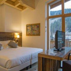 Отель Garnì Caminetto Горнолыжный курорт Скирама Доломити Адамелло Брента комната для гостей фото 2