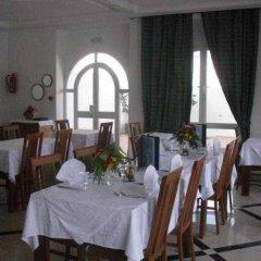 Отель Menzel Dija Appart-Hotel Тунис, Мидун - отзывы, цены и фото номеров - забронировать отель Menzel Dija Appart-Hotel онлайн питание