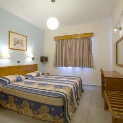 Отель Kefalos Damon Hotel Apartments Кипр, Пафос - отзывы, цены и фото номеров - забронировать отель Kefalos Damon Hotel Apartments онлайн комната для гостей фото 5