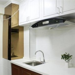 Апартаменты Xingfu Huafu Apartment в номере