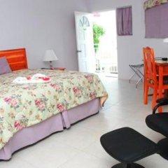 Отель Rondel Village Ямайка, Саванна-Ла-Мар - отзывы, цены и фото номеров - забронировать отель Rondel Village онлайн комната для гостей