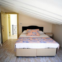 Kandira Butik Hotel Чешме сейф в номере