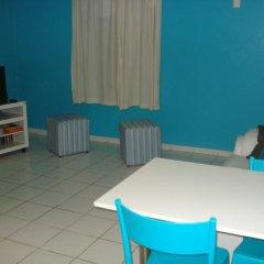 Отель Coqueiros Residence комната для гостей