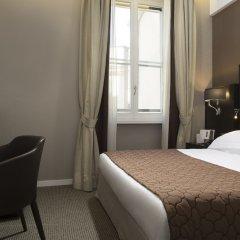 Отель Artemide сейф в номере