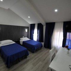 Отель Rose Garden Hotel Албания, Шкодер - отзывы, цены и фото номеров - забронировать отель Rose Garden Hotel онлайн комната для гостей