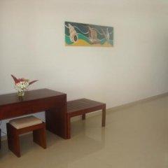 Отель Whispering Palms Hotel Шри-Ланка, Бентота - отзывы, цены и фото номеров - забронировать отель Whispering Palms Hotel онлайн удобства в номере фото 2
