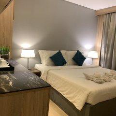 Отель Green Suites at Bel Air Soho Филиппины, Макати - отзывы, цены и фото номеров - забронировать отель Green Suites at Bel Air Soho онлайн комната для гостей фото 2