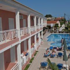 Отель Angelina Hotel & Apartments Греция, Корфу - отзывы, цены и фото номеров - забронировать отель Angelina Hotel & Apartments онлайн бассейн фото 2