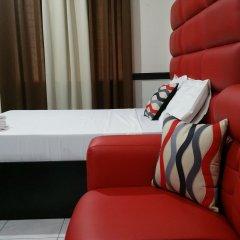 Отель Luxury Suites E Филиппины, Пампанга - отзывы, цены и фото номеров - забронировать отель Luxury Suites E онлайн комната для гостей фото 4