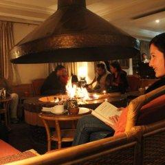 Отель Dhulikhel Lodge Resort Непал, Дхуликхел - отзывы, цены и фото номеров - забронировать отель Dhulikhel Lodge Resort онлайн интерьер отеля