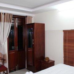 Отель Windy River Homestay сейф в номере