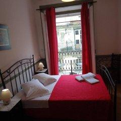 Отель Pensão Aljubarrota Португалия, Лиссабон - 1 отзыв об отеле, цены и фото номеров - забронировать отель Pensão Aljubarrota онлайн комната для гостей фото 2