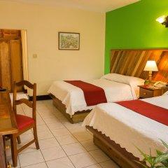 Отель Legends Beach Resort Ямайка, Негрил - отзывы, цены и фото номеров - забронировать отель Legends Beach Resort онлайн комната для гостей фото 2