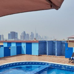 Отель Arabian Dreams Deluxe Hotel Apartments ОАЭ, Дубай - отзывы, цены и фото номеров - забронировать отель Arabian Dreams Deluxe Hotel Apartments онлайн бассейн фото 2