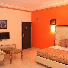 Отель Calabar Harbour Resort SPA Нигерия, Калабар - отзывы, цены и фото номеров - забронировать отель Calabar Harbour Resort SPA онлайн комната для гостей фото 2