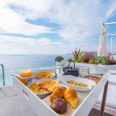 Отель Santorini Secret Suites & Spa бассейн