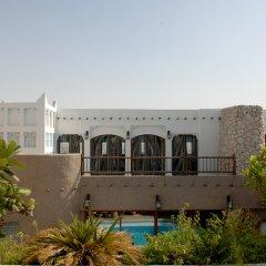 Отель Al Liwan Suites пляж