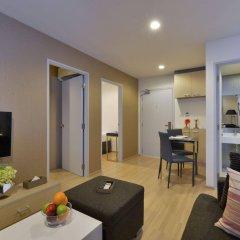 Отель The Grass Serviced Suites by At Mind комната для гостей фото 5