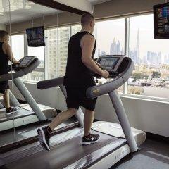 Отель Jumeira Rotana фитнесс-зал фото 4