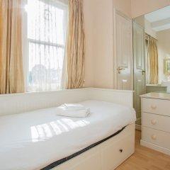 Апартаменты Lovely 2 Bedroom Apartment Near Hyde Park Лондон комната для гостей фото 4