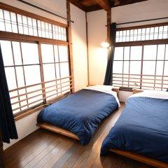 Taketa station hostel cue Минамиогуни комната для гостей фото 4