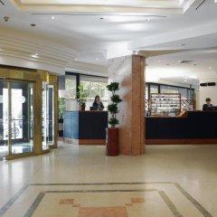 Отель NH Torino Centro интерьер отеля