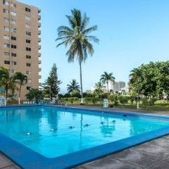 Апартаменты Deluxe Turtle Towers Apartments бассейн