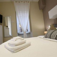Отель APPARTAMENTO SANTI QUATTRO 1 e 2 - COLOSSEO комната для гостей