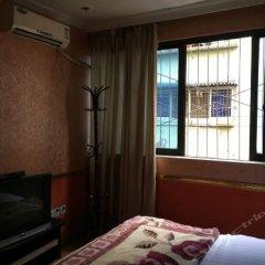 Xinyi Business Hostel комната для гостей