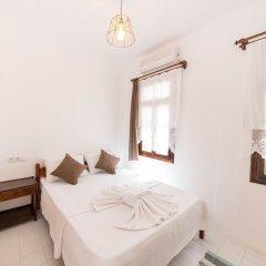 Отель Old Kalamaki Pansiyon Калкан комната для гостей фото 5