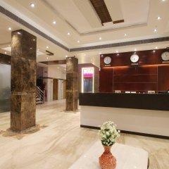 Отель OYO 16011 Hotel Mohan International Индия, Нью-Дели - отзывы, цены и фото номеров - забронировать отель OYO 16011 Hotel Mohan International онлайн интерьер отеля